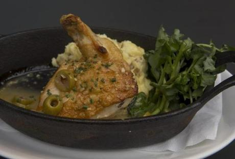 Roast chicken with mashed potatoes, lemon jus, and Spanish olives.