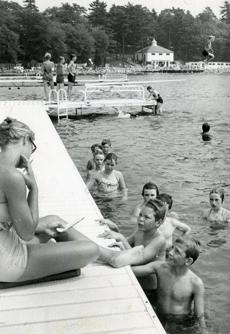 August 17, 1960:  Young swimmers appeared to be waiting for their next swimming assignment from their instructor on the deck.