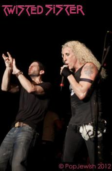 "Rabbi Darby Leigh using sign language onstage in New York with Twisted Sister's lead singer Daniel ""Dee"" Snider"