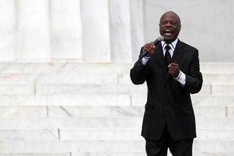 WASHINGTON, DC - AUGUST 28: Seventh-day Adventist minister and vocal artist Rev. Wintley Phipps, Sr., sings during the Let Freedom Ring ceremony at the Lincoln Memorial August 28, 2013 in Washington, DC. The event was to commemorate the 50th anniversary of Dr. Martin Luther King Jr.'s