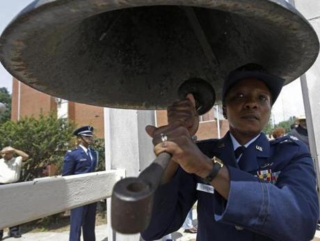 ROTC Lt. Col. Tangela Spencer rings the bell 50 times as elementary students recite verses from the