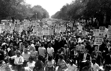 FKing (center left, with arms raised) marched along Constitution Avenue with other civil rights protesters.