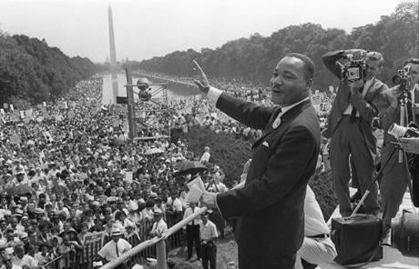 The Rev. Martin Luther King Jr. waved to supporters on the Mall during the