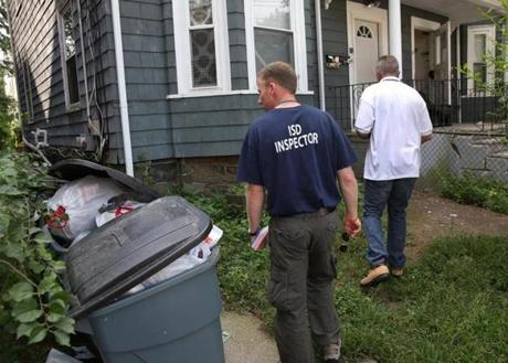 City inspectors fanned out in search of code violations by landlords on Friday.