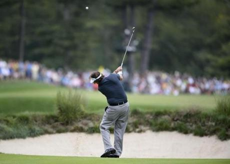 Phil Mickelson hits from the fairway on No. 5, which he would par.