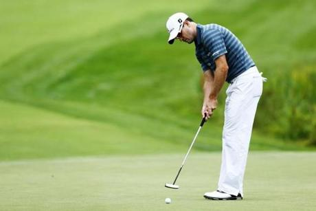 Zach Johnson, who shot 69, rolls a putt on the sixth green.