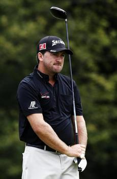 Driver in hand, Graeme McDowell of Northern Ireland surveys the scene from the 14th tee.