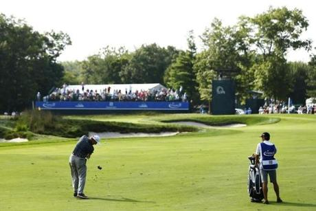 Ernie Els, a four-time major champion, shows his elegant form on this approach to the ninth hole.