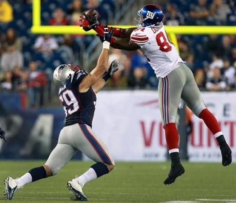 Wide receiver Larry Donnell (right) leaped and caught a pass that deflected off his hands.