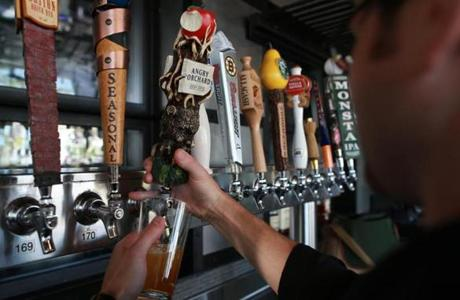 Yard House bartender Jeff Reddington poured a pint of Angry Orchard from its distintive tap.
