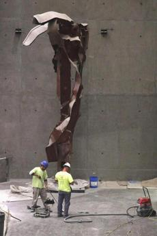 "Visitors toured the National September 11 Memorial & Museum, located on the site of the World Trade Center, on Saturday. The facility will be open to the public in spring 2014. At left are steel facade segments from the South Tower, to be exhibited as ""Impact Steel."""