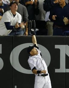 Yankees right fielder Ichiro Suzuki missed on his leaping attempt to catch Mike Napoli's grand slam in the seventh.