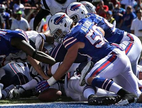 Bills linebacker Kiko Alonso recovered Brady's fumble.