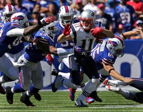 Wide receiver Julian Edelman fought for yardage in the first half.