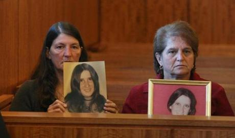 Cindy Vanasse (left) and Beverly Souza held up pictures of their slain sister, Gayle Botelho, before Monday's arraignment of Daniel T. Tavares Jr. in Bristol Superior Court.
