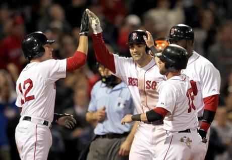 The Red Sox finally stopped their skid in the nightcap, however, when a seven-run seventh powered an 18-9 win. A grand slam by Conor Jackson, center, was the big hit in the inning.
