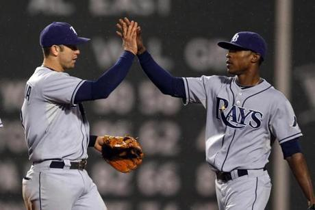 Tampa's Evan Longoria, left, hit a three-run home run to key the victory for the surging Rays. After, he celebrated with Upton.