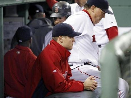 Boston Red Sox relief pitcher Jonathan Papelbon sits in the dugout after the Red Sox lost 7-5 to the Baltimore Orioles in a baseball game at Fenway Park in Boston, Tuesday, Sept. 20, 2011. Papelbon gave up a three-run double to Robert Andino in the eighth inning. (AP Photo/Elise Amendola)