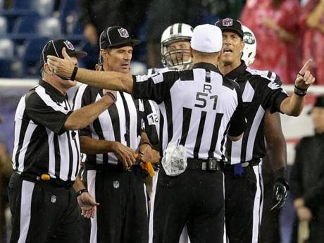 The officiating crew sorted out the penalties after the scrum. The Jets' D'Brickashaw Ferguson and Willie Colon were ejected.