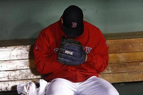 A dejected Alfredo Aceves lingered in the Red Sox dugout after surrendering a hit that delivered the go-ahead runs in a 6-4 loss to the Orioles on Sept. 21.