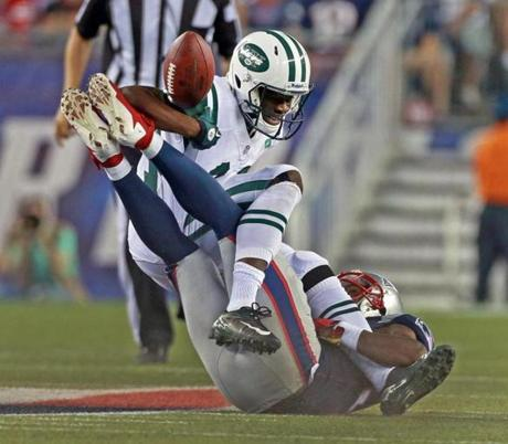 Jets wide receiver Stephen Hill fumbled the ball as he was hit by the Patriots' Aqib Talib in the first quarter.