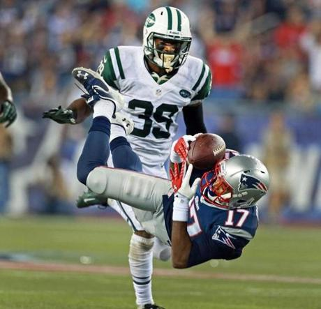 Dobson dropped a pass as the Jets' Antonio Allen defended.