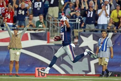 Patriots wide receiver Aaron Dobson (left) was on air as he headed to the end zone with his 39-yard touchdown reception in the first quarter.