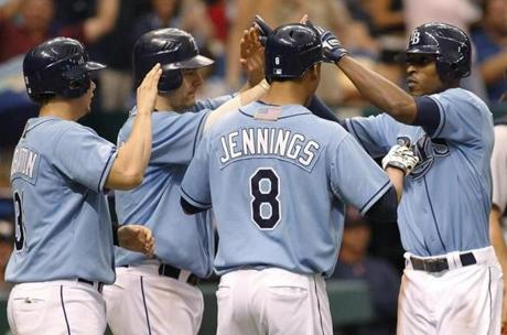 B.J. Upton's grand slam fueled a 9-1 win in the series finale on Sept. 11, and the Rays closed the gap in the playoff race to 3 1/2 games.