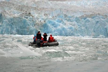 The authors and others rode Zodiacs close to the face of South Sawyer glacier.