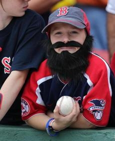 Harry Vaughn, 10, of Wakefield was wearing his Napoli/Red Sox playoff beard before Saturday's game.