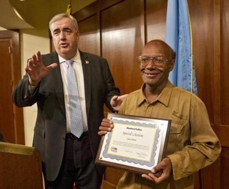 Police Commissioner Edward F. Davis gave a citation honoring Glen James in Boston.