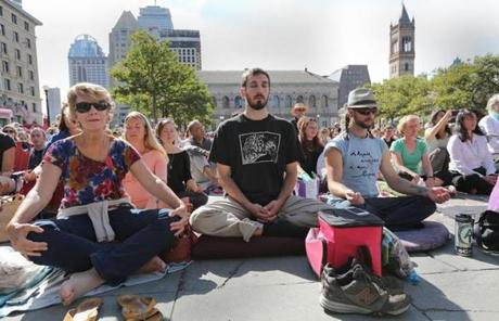 Carol Hudgins of Cincinnati, Jim Piermarini Jr. of Amesbury, and Drew Amabile of Cambridge meditated along with Hanh.