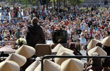 Hanh meditated in front of a crowd of about 2,000.