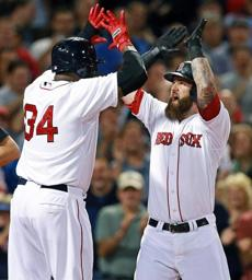 Napoli (right) celebrated the home run with David Ortiz.