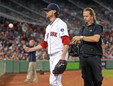 Buchholz was tailed by an ESPN cameraman as he tossed the ball to a fan in the sixth inning.