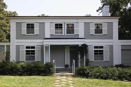 This Belmont Colonial features 10-foot ceilings, walls free of crown molding, and a curving staircase evocative of the era when it was built, 1936.