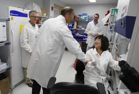 Sanofi chief Chris Viehbacher, with Dimitri Wiederschain (left), met Chaomei Shi and Tim Wagenaar (right) in Cambridge, where about 230 researchers are expected to work.