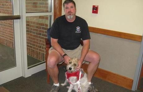 James Glaser, a veteran from Iraq, and his service dog, Jack, a Jack Russell terrier, were turned away from an Oxford diner in August.