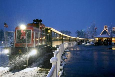 The Edaville train in snow during christmas lights festival.