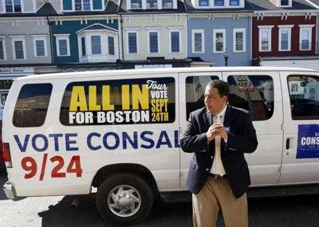 Mayoral candidate Rob Consalvo waits to greet potential voters on East Broadway in South Boston, Massachusetts September 19, 2013. (Jessica Rinaldi For The Boston Globe)