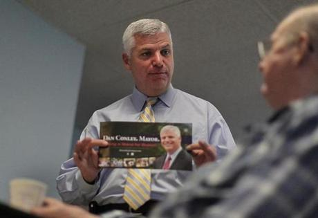 Boston, MA., 09/19/13, A day in the life of the mayoral candidates. Dan Conley campaigns in South Boston at the Msgr. Powers Apartments. He shows his promotional flyer at the end of his speech to Leo McCarthy, cq. Suzanne Kreiter/Globe staff