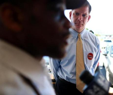 Boston Ma 09/18/2013 Boston mayoral candidate Marty Walsh. (cq) listened to a interview while campaigning in Charlestown. Various Mayoral Candidates .( Jonathan.Wiggs )Topic:Section:Reporter: Topic: Reporter: