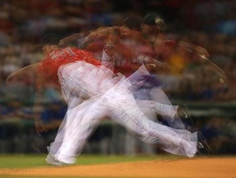 Jon Lester was shown in motion during the first inning of Friday's game.