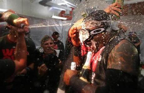 Ortiz took a direct hit of celebratory champagne during the clubhouse celebration.