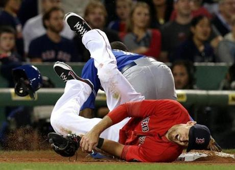 Will Middlebrooks and Blue Jays outfielder Rajai Davis collided in the fifth inning, when Davis stole third base.