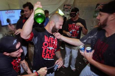 John Lackey tugged on Mike Napoli's beard in the clubhouse.