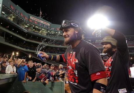 Jarrod Saltalamacchia (left) and Jonny Gomes celebrated as they made their way off the Fenway Park turf.