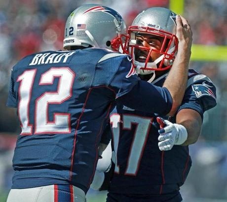 Brady (left) celebrated the play with Aaron Dobson.