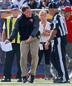 Buccaneers head coach Greg Schiano argued with side judge Dave Wyant (right), to no avail.