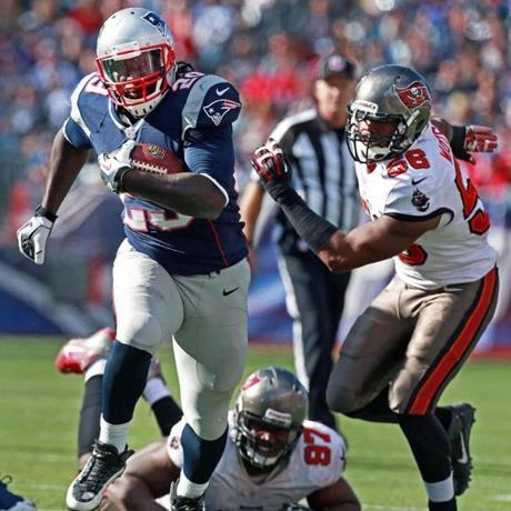 LeGarrette Blount left Tampa Bay's Akeem Spence and Dekoda Watson in the dust as he pushed for yardage in the fourth quarter.